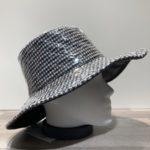Capeline de pluie tissu ouatiné et soudé avec film transparent gris doublé