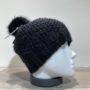 Bonnet tricot uni noir fil en lurex brillant doublé avec pompon Herman